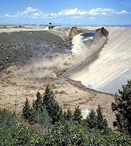 The Teton Dam Failure of June 1976 resulted when the dam burst when the water was 270 feet deep during the first filling of the reservoir. It drained in less than 6 hours, setting off more than 200 landslides in the canyon below, taking eleven lives, and causing millions of dollars of property damage. Photo credit: U.S. Bureau of Reclamation.