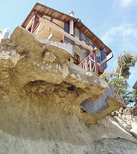 The Laguna Beach Landslide of June 2005 was due to extremely heavy winter rainfall that had soaked the soil and raised groundwater, destabilizing the slope of Bluebird Canyon. This home was undermined and eleven homes were destroyed. Photo credit: Pamela Irvine/California Geological Survey.